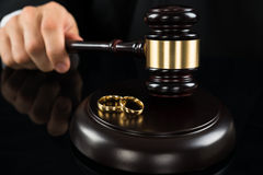 Close-up Of Judge Hitting Gavel With Rings Stock Photography