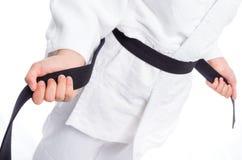 Close up of judo uniform, judo-gi, with belt isolated on white Royalty Free Stock Image