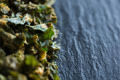 Close-up of kale on slate. Close-up of cooked kale on wooden plate Royalty Free Stock Photos