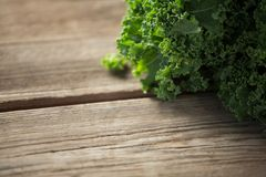 Close-up of kale on table. Close-up of fresh kale on wooden table Royalty Free Stock Images