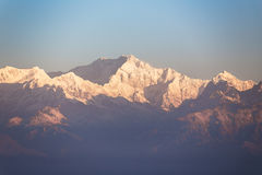 Close-up Kangchenjunga mountain in the morning with blue and orange sky that view from The Tiger Hill in winter at Tiger Hill. Close-up Kangchenjunga mountain Stock Photo