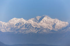 Close-up Kangchenjunga mountain in the morning with blue and orange sky that view from The Tiger Hill in winter at Tiger Hill. Close-up Kangchenjunga mountain Royalty Free Stock Photos