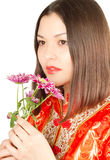 Close up of kazakh woman with pink flowers Royalty Free Stock Images