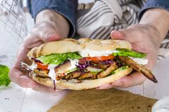 Close up of kebab sandwich on wooden background stock photos