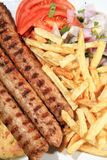 Kebab with fried potatoes Stock Images
