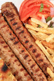 Kebab with fried potatoes Royalty Free Stock Photo