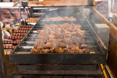 Close Up of Kebabs Roasting on Hot Grill Royalty Free Stock Image
