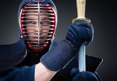 Close up of kendo fighter with shinai Stock Photography
