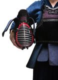 Close up of kendo helmet in hands of kendo fighter Royalty Free Stock Images