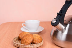 Close up of  kettle, cup and cakes Royalty Free Stock Photos