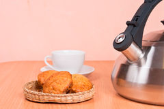 Close up of  kettle, cup and cakes Stock Photos
