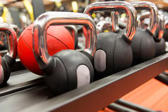 Close up of kettlebells and medicine ball in gym Royalty Free Stock Images