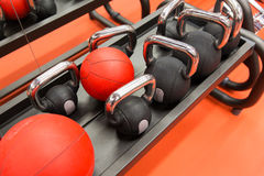 Close up of kettlebells and medicine ball in gym Stock Photography