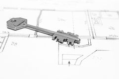 Close up of key on house plan Stock Photography