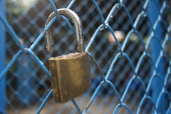 Close up a key lock hook on iron wire gates and water drop of rain with blur background,selective focus,filtered image Royalty Free Stock Photo