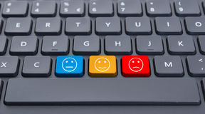 Close-up keyboard with three smiley keys Stock Photo