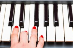 Close up of Keybord of synthesizer and woman hands Stock Photo