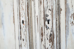 Close-up of keyhole ancient white commode bureau furniture with paint peeled off Royalty Free Stock Photography