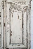 Close-up of keyhole ancient white commode bureau furniture with paint peeled off Royalty Free Stock Images
