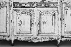 Close-up of keyhole ancient white commode bureau furniture with paint peeled off Stock Photos