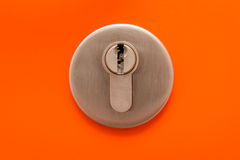 Close up of keyhole on orange door Royalty Free Stock Photo