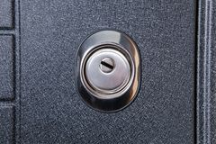 Close up of keyhole in round lock on iron Royalty Free Stock Photos