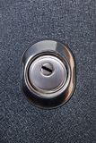 Close up of keyhole in round lock, safety concept Stock Images
