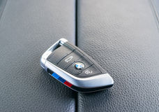 Close up of keys of BMW X5M 2017 in black leather car interior, car interior details Stock Photos