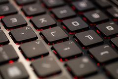 Close up of the keys on a QWERTY keyboard. Close up of the keys on a sleek QWERTY keyboard stock images
