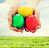 Close up of kid hands holding colored eggs Royalty Free Stock Photo