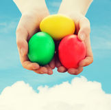 Close up of kid hands holding colored eggs Stock Images