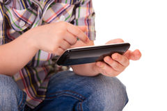 Kid hands using mobile smart phone Royalty Free Stock Image