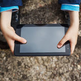 Close-up of kid's hands close up holding digital tablet Stock Photos
