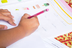 Close up Kids doing homework Royalty Free Stock Images