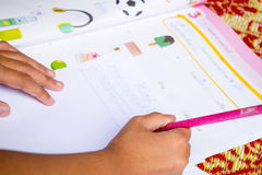 Close up Kids doing homework Stock Image