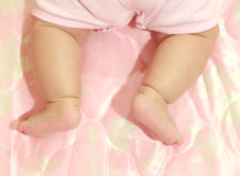 Close-up kids foot pure in blanket Royalty Free Stock Image
