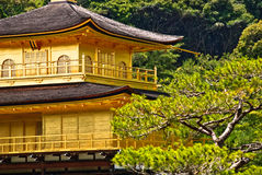 Close up of Kinkaku-ji temple in Kyoto, Japan. Close up of Kinkaku-ji temple, a Zen Buddhist sanctuary in Kyoto, Japan. The top two stories of the pavilion are Stock Photos