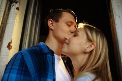Close-up of kissing and embracing couples in old, doorway, family. date, attraction. family happiness. Close-up of kissing and embracing couples in old,doorway royalty free stock photography