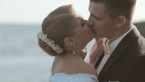 Close-up of kissing newlyweds standing among the stock video footage