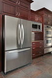 Close up of kitchen. Cabinets and refrigerator Royalty Free Stock Image
