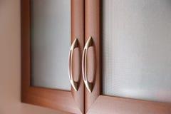 Close up of kitchen cabinet door handles stock image