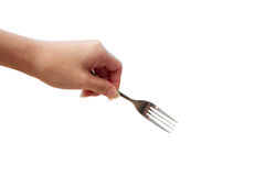 Close up of kitchen fork in hand. Isolated Royalty Free Stock Images