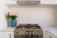 Close up of kitchen oven and tiled splashback Royalty Free Stock Image
