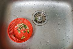 Kitchen sink with food sieve avoid drain blockages. Close up kitchen sink with food sieve avoid drain blockages stock photography