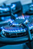 Close-up kitchen stove cook with blue flames burning.  royalty free stock photo