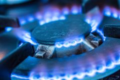 Close-up kitchen stove cook with blue flames burning.  stock photography