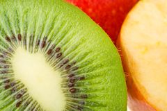Close-up kiwi and apples Stock Image