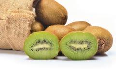 Close up kiwi friut in sack. On white background stock photos