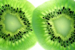 Close-up of Kiwi Fruit. Two sections. Back light Royalty Free Stock Image