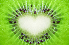 Close up of kiwi fruit texture background with heart shape Royalty Free Stock Image